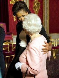 michelle-obama-touching-queen