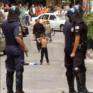 Kid Flexing Against Soldiers